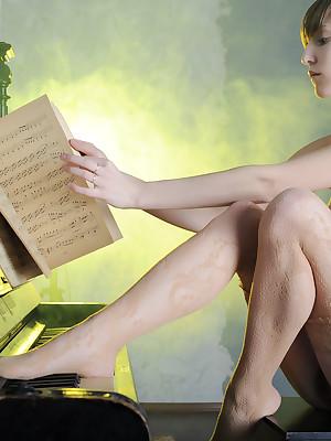 Bare woman haler than piano